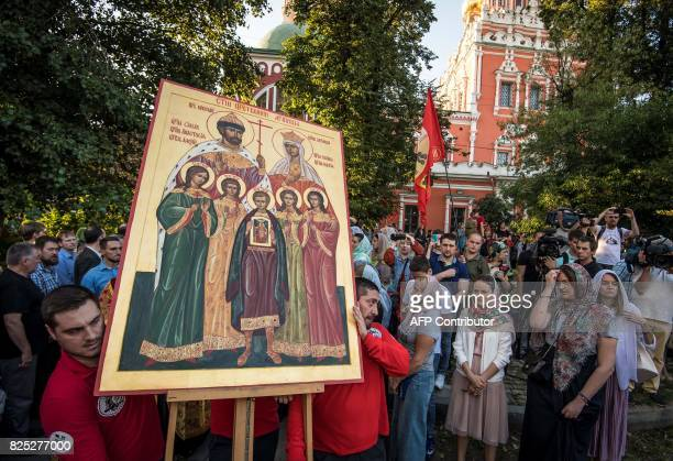 Russian Orthodox believers carry an icon depicting the canonised family of the last Russian Tsar Nikolay II during a protest against the movie...