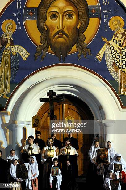 Russian Orthodox believers celebrate Easter in a church in Moscow early on May 5 2013 AFP PHOTO/ANDREY SMIRNOV