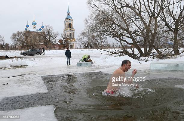 Russian Orthodox beliver bathes in the icy water of a lake in Ilyinskoye Russia Monday January 2015 Thousands of Russian Orthodox Church followers...