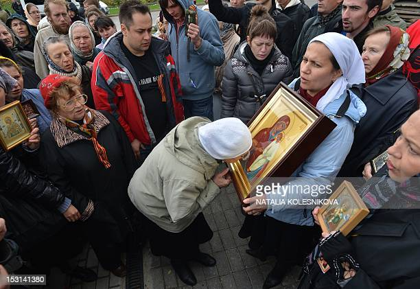 Russian Orthodox church faithful crowd outside the city court in Moscow on October 1 during a court hearing of the allgirl punk band 'Pussy Riot'...