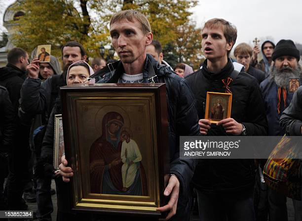 Russian Orthodox church faithful hold icons as crowd outside the city court in Moscow on October 10 during a hearing into the appeal of three members...