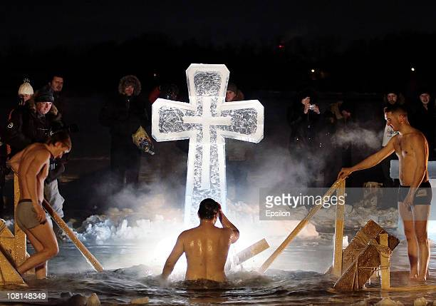 Russian Orthodox faithful plunge in the icy waters of a pond in celebration of the Epiphany holiday early on January 19 2011 in Moscow Russia...