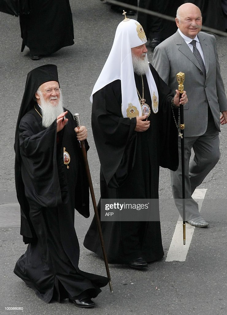 Russian Orthodox Patriarch Kirill (C), Ecumenical Patriarch Bartholomew (L), and Moscow Mayor Yuri Luzhkov (R) walk during a ceremony in central Moscow on May 24, 2010, while celebrating the Holiday of St. Cyril and Methodius, the creators of Cyrillic alphabet and symbols of Slav culture.