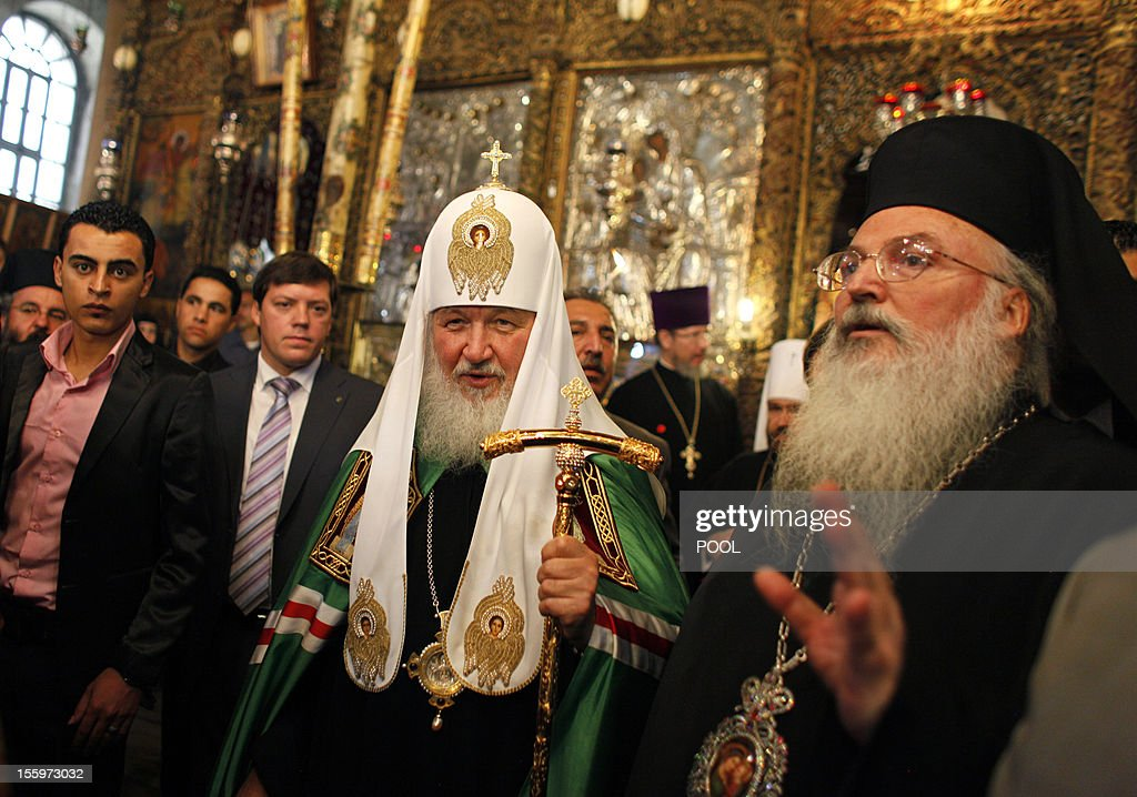 Russian Orthodox Patriarch Kirill (C) leaves the Church of Nativity, in the West Bank biblical city of Bethlehem, on November 10, 2012. Kirill, the head of a community of some 150 million Orthodox believers, arrived in Jerusalem on November 9, for his first visit since becoming head of the powerful church in 2009, and held prayers at the Church of the Holy Sepulchre.