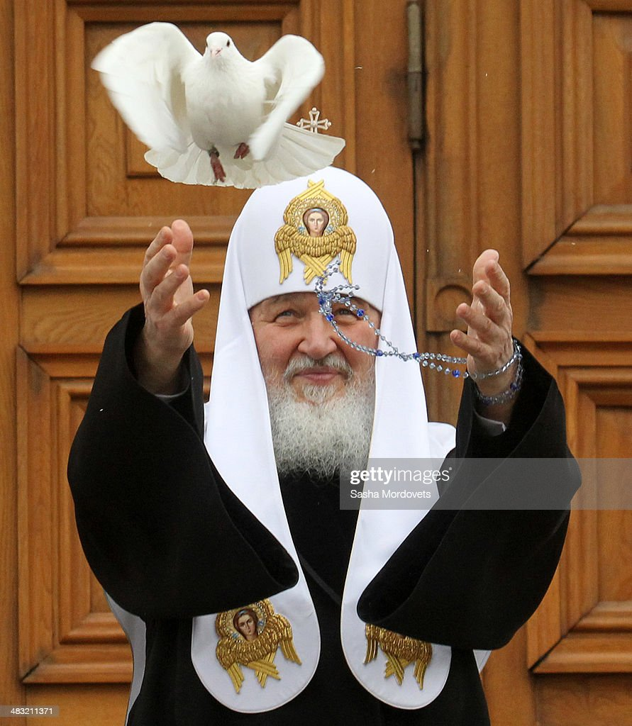 Russian Orthodox Patriarch Kirill releases a white pigeon after the Annunciation service at Annunciation Cathedral (Blagoveshchensky Sobor) on April 7, 2014 in Moscow's Kremlin. The Annunciation is a Chrisitan celebration of the revelation to the Virgin Mary by Archangel Gabriel that she would bear a son, Jesus, the Son of God. The religious service has been administered at the Catherdral by the Patriarch of Moscow and All Russia since 1993.