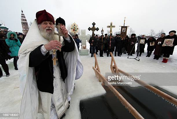 Russian Orthodox Priest attends an Orthodox Epiphany mass on January 19 2013 in the Yaroslavl region 260 km north of Moscow Russia People all over...