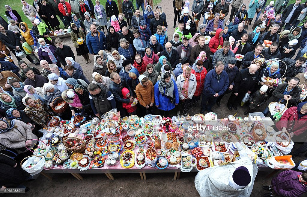 A Russian Orthodox priest blesses cakes and colored eggs during an Orthodox Easter ceremony at the Pokrovsky Cathedral in St. Petersburg, Russia, on April 30, 2014, on the eve of the Orthodox Easter.