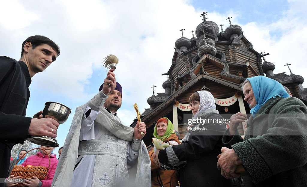 A Russian Orthodox priest blesses cakes and colored eggs during an Orthodox Easter ceremony at the Pokrovsky Cathedral in St. Petersburg, Russia, on April 30, 2016, on the eve of the Orthodox Easter.