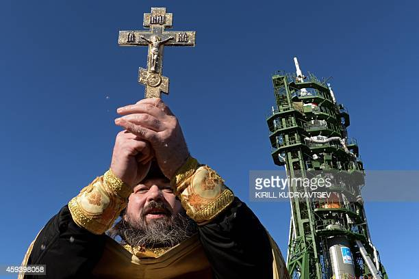 A Russian Orthodox priest blesses the Soyuz TMA15M spacecraft at the launch pad of the Russianleased Baikonur cosmodrome on November 22 2014 The...