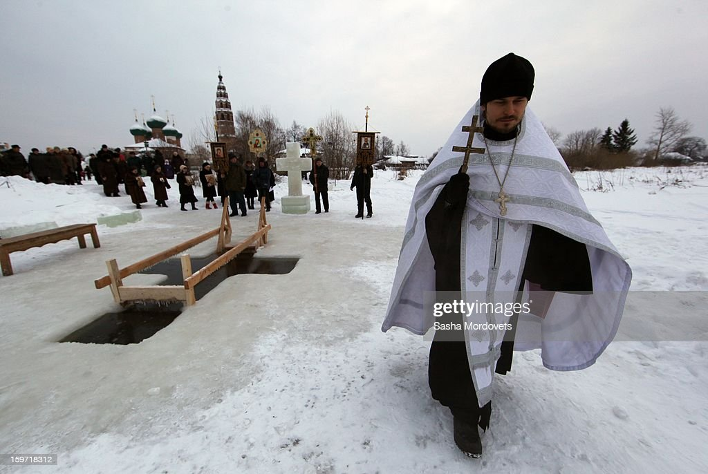 A Russian Orthodox Priest prays during an Orthodox Epiphany mass on January 19, 2013 in the Yaroslavl region, 260 km north of Moscow, Russia. People all over Russia are taking part in a baptism ceremony, one the biggest events in the Christian Orthodox calendar.