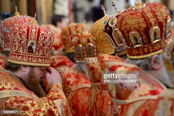 Russian Orthodox priests take part in a religious service marking Saints Cyrilius and Methodius' Day in Uspensky Cathedral in the Moscow Kremlin on...