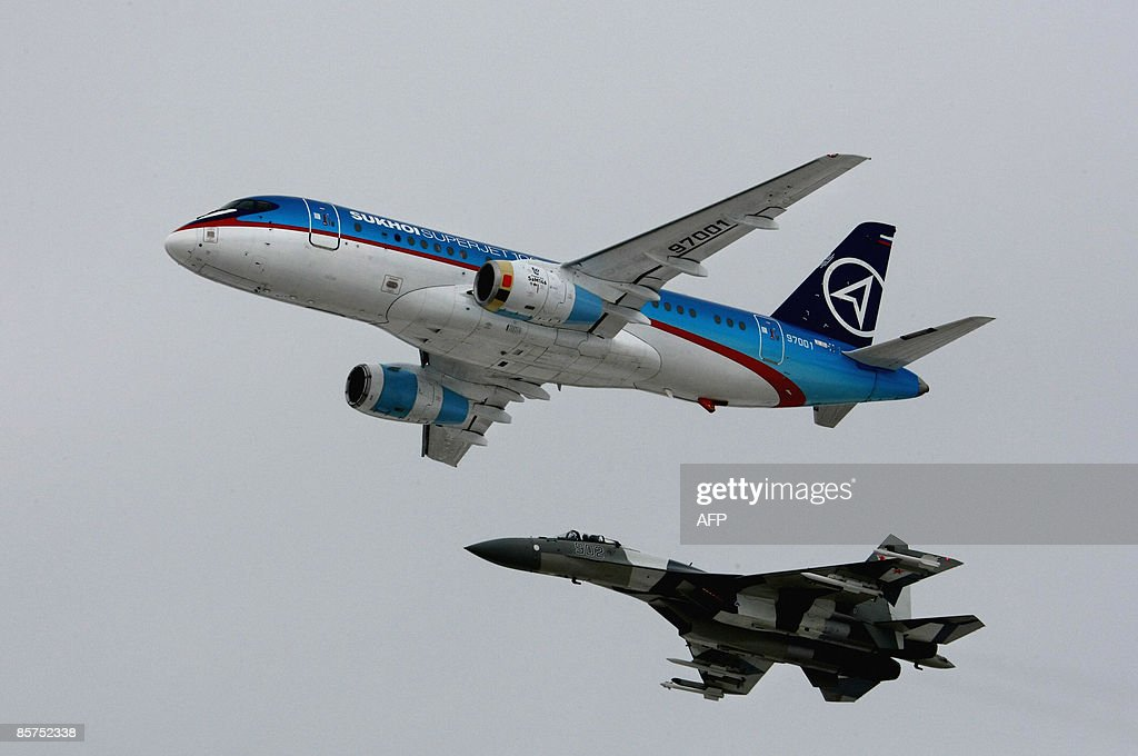 A Russian passenger Sukhoi Superjet 100 aircraft with a Russian fighter jet escort lands at an airstrip just outside Moscow on April 1 2009 The plane...
