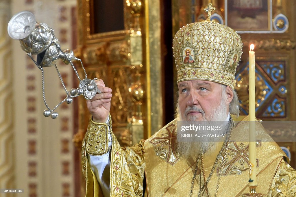 Russian Patriarch Kirill celebrates a Christmas service in Christ the Savior cathedral in Moscow early on January 7, 2015. Orthodox Christians celebrate Christmas on January 7 in the Middle East, Russia and other Orthodox churches that use the old Julian calendar instead of the 17th-century Gregorian calendar adopted by Catholics, Protestants, Greek Orthodox and commonly used in secular life around the world. AFP PHOTO/KIRILL KUDRYAVTSEV
