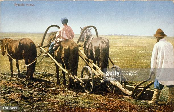 Russian peasants tilling a field in the late 19th century