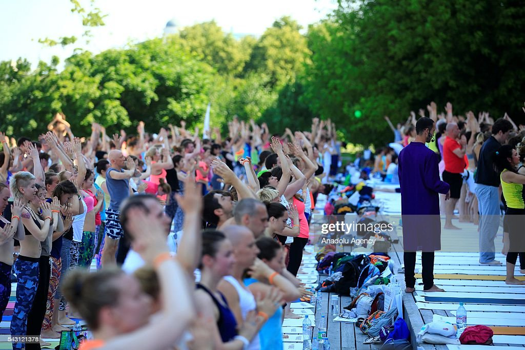 Russian people perform yoga exercises during the 2th International Yoga Day Russia at the Park Muzeon in Moscow, Russia, on June 26, 2016.