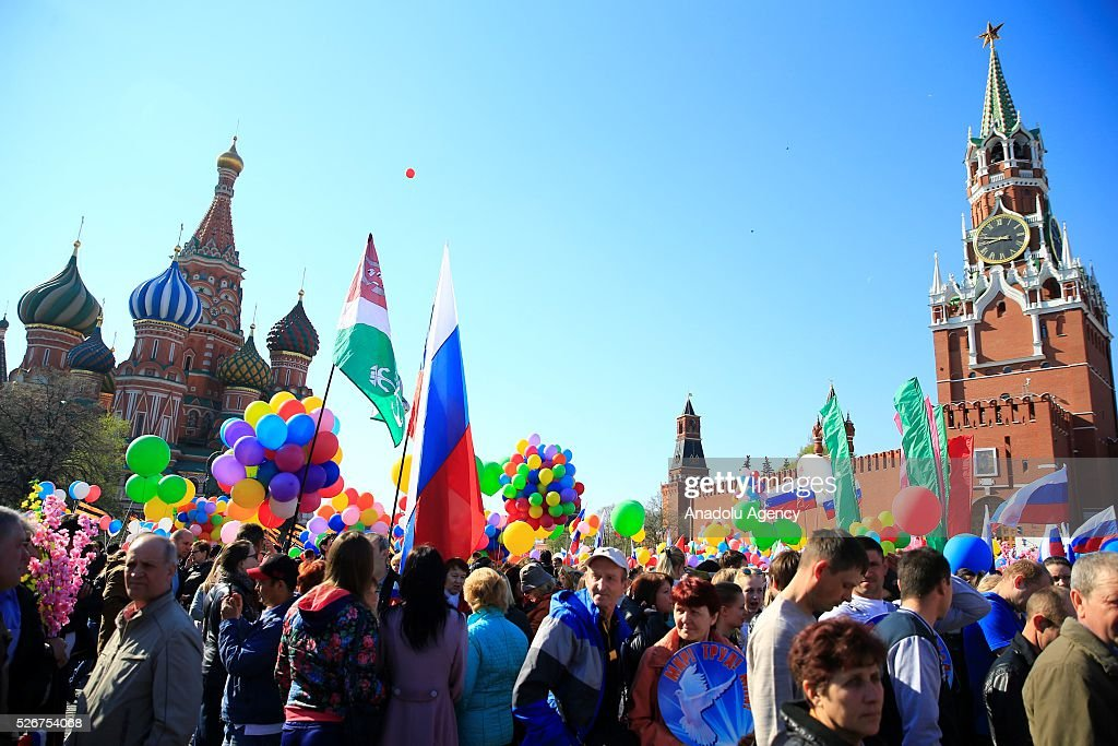 Russian people take part in a rally to mark May Day, International Workers' Day, at the Red Square, in Moscow, Russia, on May 1, 2016.