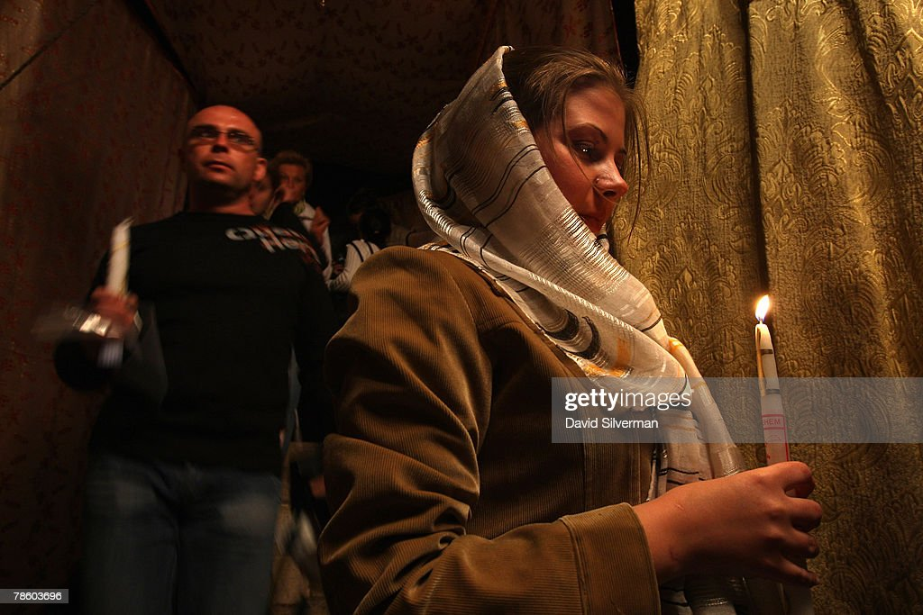 Russian pilgrims carry candles as they walk down to the Grotto of the Church of the Nativity, the traditional birthplace of Jesus, December 21, 2007 in Bethlehem in the West Bank. The biblical town is celebrating both Christmas and the Muslim Eid al-Adha over the next few days.