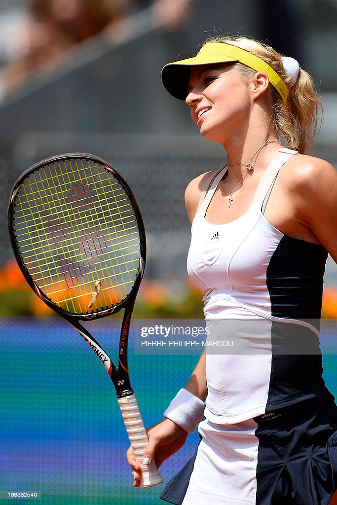 Russian player Maria Kirilenko reacts during her women's singles third round tennis match against US player Serena Williams at the Madrid Masters at the Magic Box (Caja Magica) sports complex in Madrid on May 9, 2013. Williams won the match 6-3, 6-1. AFP PHOTO / PIERRE-PHILIPPE MARCOU