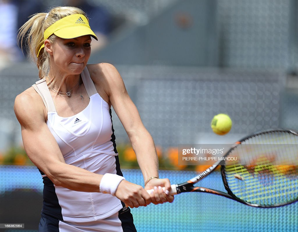 Russian player Maria Kirilenko returns the ball to US player Serena Williams during their women's singles third round tennis match at the Madrid Masters at the Magic Box (Caja Magica) sports complex in Madrid on May 9, 2013. AFP PHOTO / PIERRE-PHILIPPE MARCOU