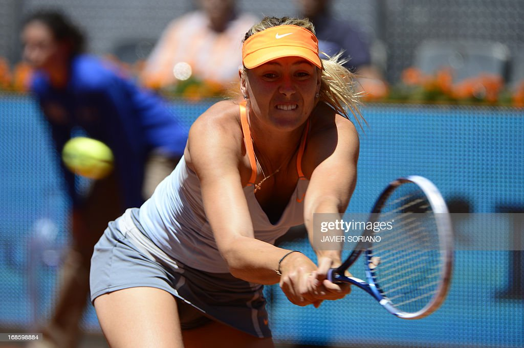 Russian player Maria Sharapova returns the ball to US player Serena Williams during their women's singles final tennis match at the Madrid Masters at the Magic Box (Caja Magica) sports complex in Madrid on May 12, 2013. AFP PHOTO / JAVIER SORIANO