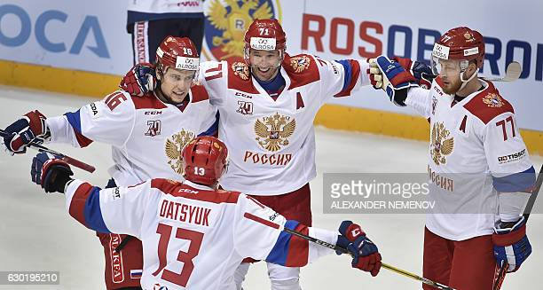 Russian player Sergey Plotnikov Pavel Datsyuk Ilya Kovalchuk and Anton Belov celebrate after scoring a goal during the Channel One Cup of the Euro...