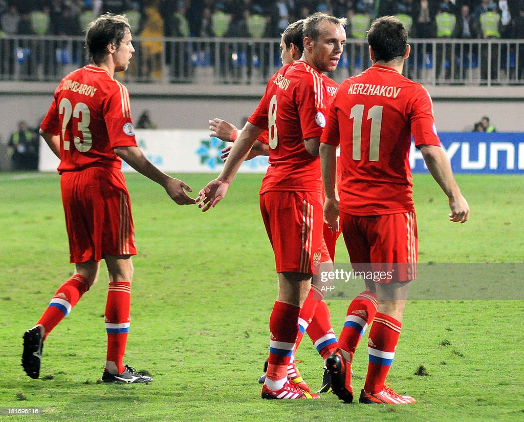 Russian players celebrate after scoring against Azerbaijan on October 15, 2013 during a FIFA 2014 World Cup qualifying football match in Baku.