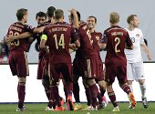 Russian players celebrate after scoring during the UEFA Euro 2016 qualifying football match between Russia and Liechtenstein in Moscow on September 8...