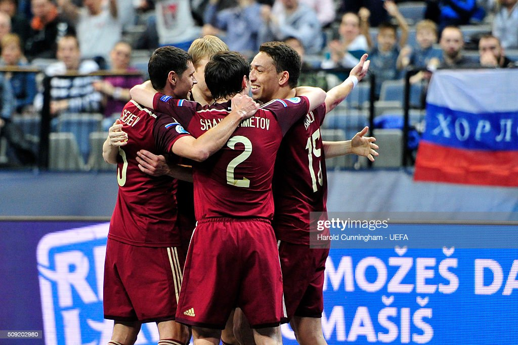 Russian players celebrate Romulo's second goal during the UEFA Futsal EURO 2016 quarter final match between Russia and Azerbaijan at Arena Belgrade on February 9, 2016 in Belgrade, Serbia.