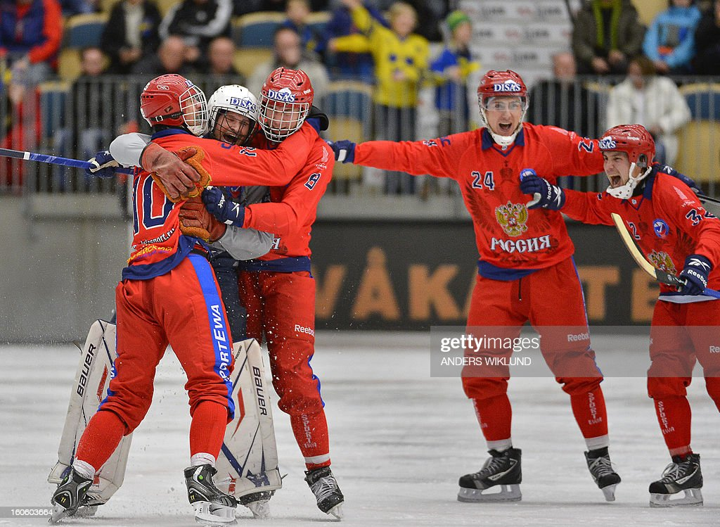 Russian players celebrate their 4-3 victory in the Bandy World Championship final match Sweden vs Russia in Vanersborg, Sweden, February 3, 2013.