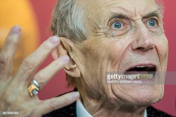 Russian poet novelist and literature professor Yevgeny Yevtushenko gestures as he speaks during a meeting with readers in Moscow on January 21 2015...