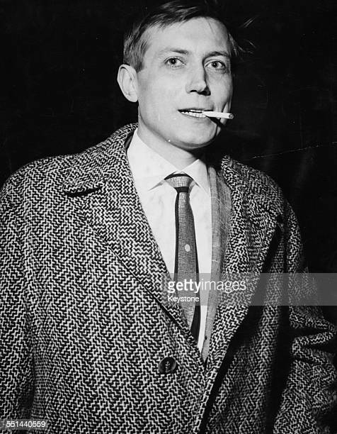 Russian poet Yevgeny Yevtushenko smoking a cigarette as he arrives in Britain at London Airport April 28th 1962