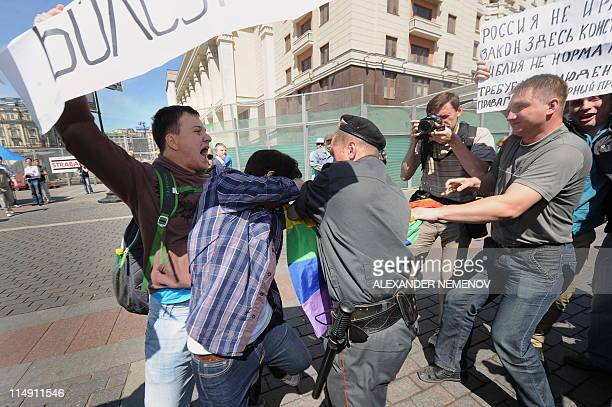 Russian police detain a gay rights activist during an attempt to hold an unauthorized rally in central Moscow on May 28 2010 Moscow police detained...