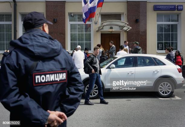 A Russian police officer stands outside the campaign headquarters of Russian opposition leader Alexei Navalny on July 6 in Moscow Russian police were...