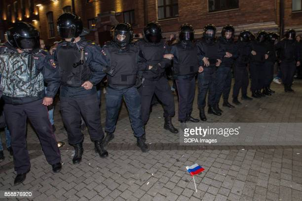 Russian police officers are seen lining up during an unauthorized opposition rally The President of Russia Vladimir Putin celebrated his 65th...