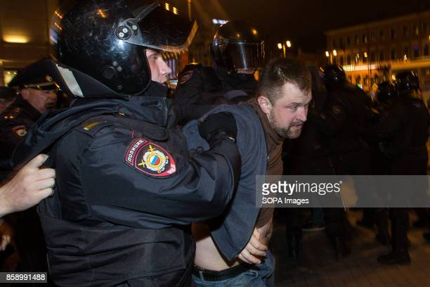 Russian police officers detain a participant of an unauthorized opposition rally in the centre of Saint Petersburg The President of Russia Vladimir...
