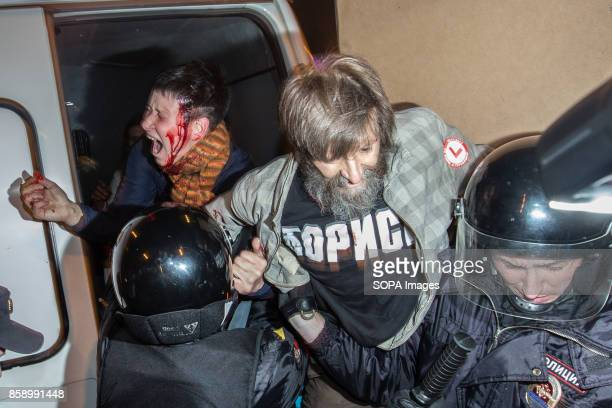 Russian police officers detain a participant of an unauthorized opposition rally The President of Russia Vladimir Putin celebrated his 65th birthday...