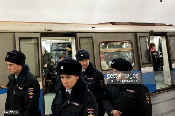 Russian police officers patrol at Prospekt Mira metro station on April 4 2017 in Moscow as security measures are tightened following the blast in the...