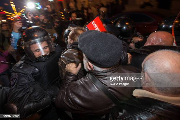 Russian police officers seen fighting with protesters during an unauthorized opposition rally The President of Russia Vladimir Putin celebrated his...