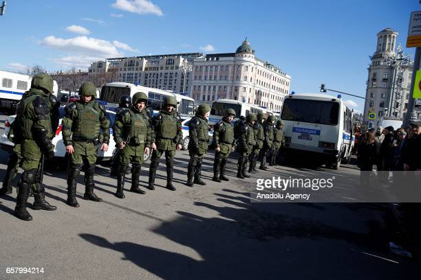 Russian police officers stand guard during an opposition rally on March 26 2017 in Moscow