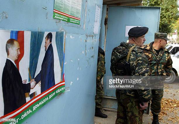 Russian police officers stand guard near a polling station in the centre of Chechen's second city Gudermes 40 kms southeast of Grozny 04 October 2003...