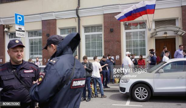 Russian police officers stand outside the campaign headquarters of Russian opposition leader Alexei Navalny on July 6 in Moscow Russian police were...
