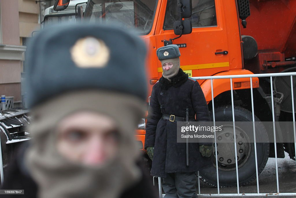 A Russian policeman stands in front of anti-Putin rally in central Moscow on January 13, 2012 in Moscow, Russia. Thousands of demonstrators gathered for a march to protest against a ban on Americans adopting Russian children.