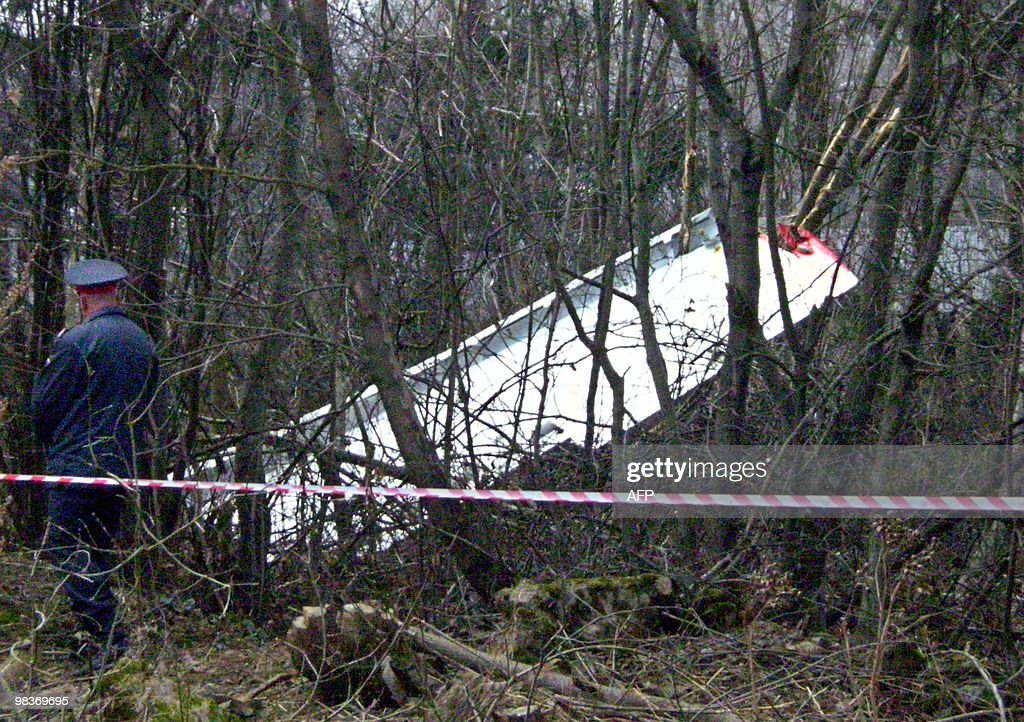 A Russian policeman walks by the wreckage of a Polish government Tupolev Tu154 aircraft that crashed near Smolensk airport April 10 2010 A plane...