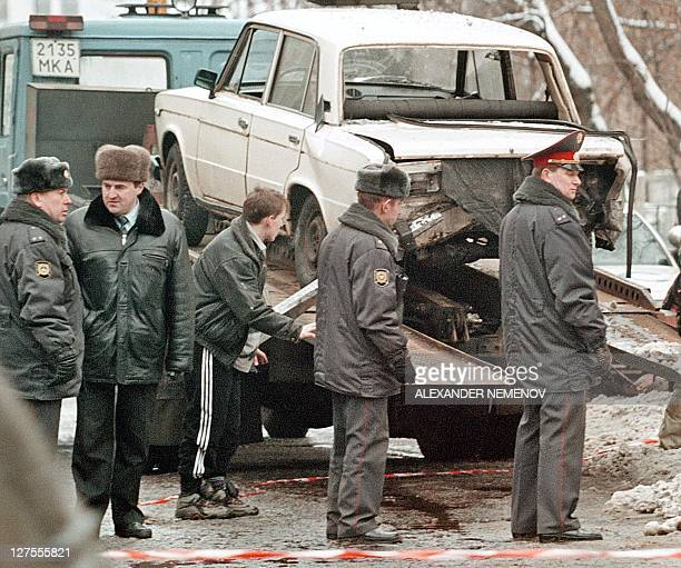 Russian policemen inspect a policeman's car after it exploded outside the US embassy in downtown Moscow 17 January after propane gas leaking from its...