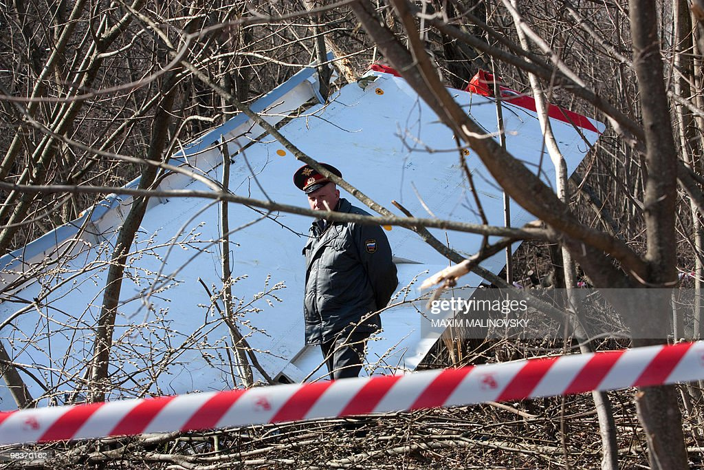 A Russian policemen walks near the wreckage of a Polish government Tupolev Tu154 aircraft that crashed near Smolensk airport on April 10 2010 A plane...