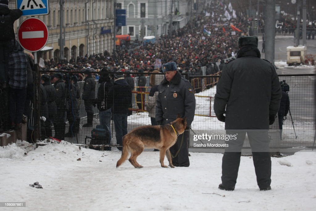 Russian policemen with dog stand in front of anti-Putin rally in central Moscow, January,13,2012. Thousands of demonstrators gathered for a march to protest against a ban on Americans adoption Russian children.