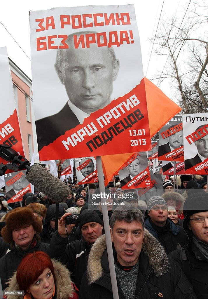 Russian politician and former Deputy Prime Minister <a gi-track='captionPersonalityLinkClicked' href=/galleries/search?phrase=Boris+Nemtsov&family=editorial&specificpeople=1017795 ng-click='$event.stopPropagation()'>Boris Nemtsov</a> attends an anti-Putin rally in central Moscow on January 13, 2012 in Moscow, Russia. Thousands of demonstrators gathered for a march to protest against a ban on Americans adopting Russian children.