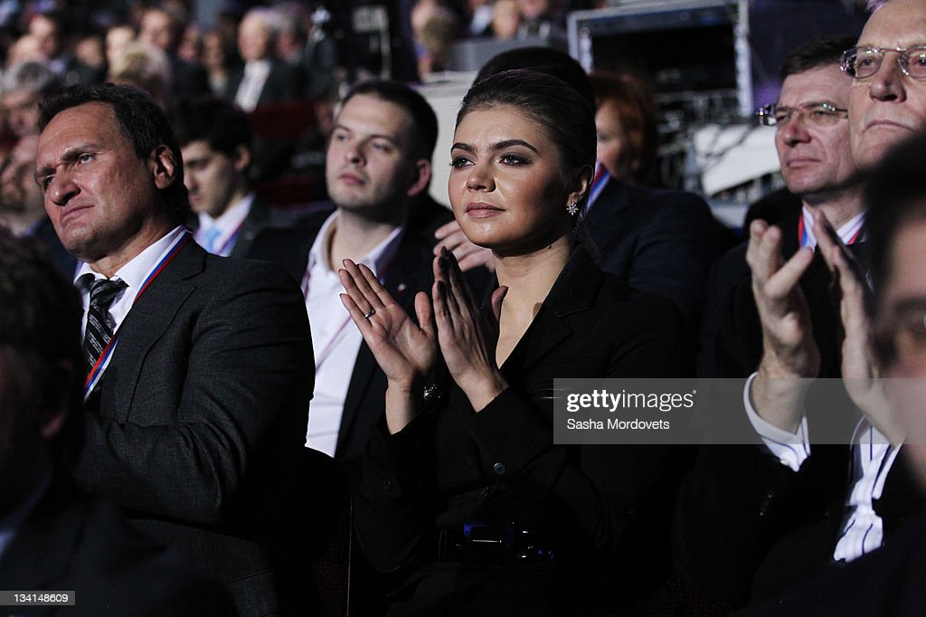 Russian politician and former Olympic Champion, <a gi-track='captionPersonalityLinkClicked' href=/galleries/search?phrase=Alina+Kabaeva&family=editorial&specificpeople=633246 ng-click='$event.stopPropagation()'>Alina Kabaeva</a>, aplauds as Prime Minister Vladimir Putin (not pictured) delivers his speech at the congress of the United Russia Party November, 27, 2011 in Moscow, Russia. Putin accepted the nomination to return to Russia's presidency ahead of the election in March.