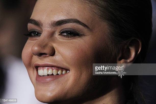 Russian politician and former Olympic Champion Alina Kabaeva smiles as Prime Minister Vladimir Putin delivers his speech at the congress of the...