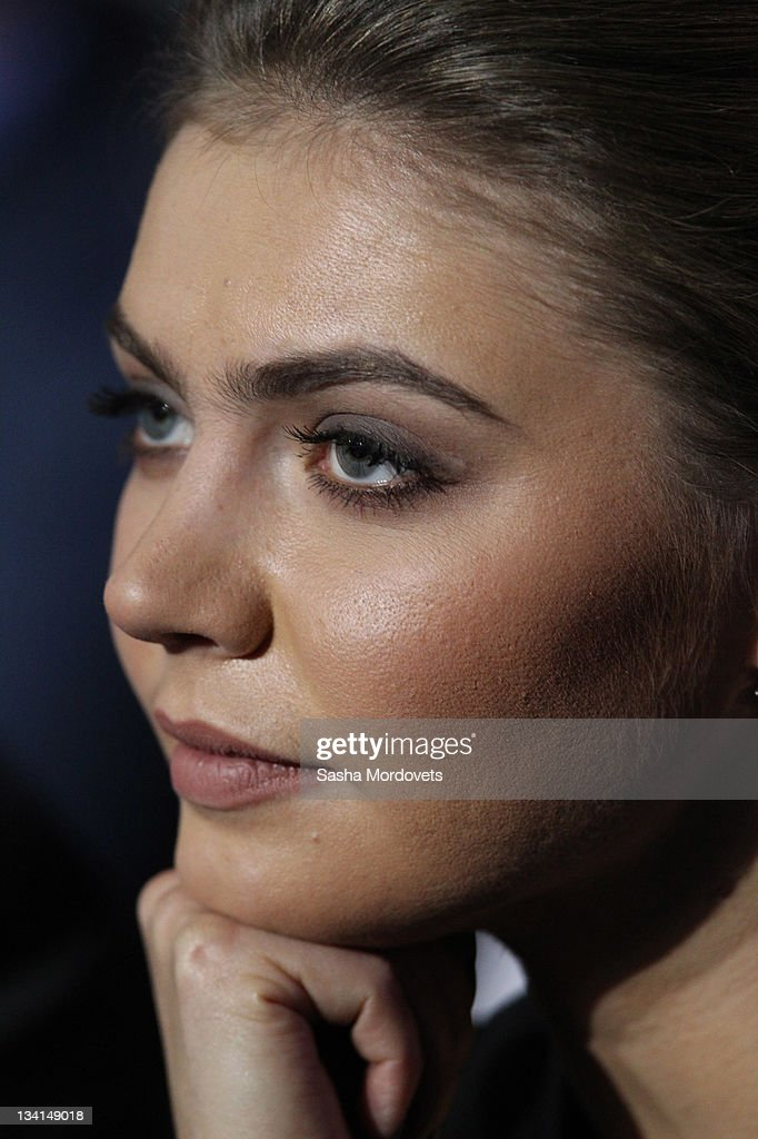 Russian politician and former Olympic Champion, <a gi-track='captionPersonalityLinkClicked' href=/galleries/search?phrase=Alina+Kabaeva&family=editorial&specificpeople=633246 ng-click='$event.stopPropagation()'>Alina Kabaeva</a>, smiles as Prime Minister Vladimir Putin (not pictured) delivers his speech at the congress of the United Russia Party November, 27, 2011 in Moscow, Russia. Putin accepted the nomination to return to Russia's presidency ahead of the election in March.